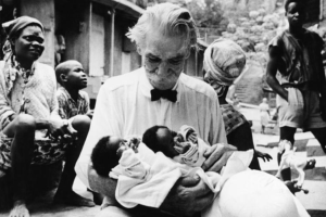 Photo of Albert holding a baby